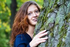 Beautiful woman next to an old tree Royalty Free Stock Photos