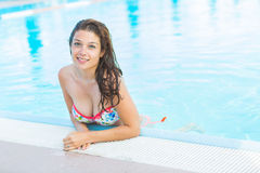 Beautiful woman next to swimming pool Stock Images