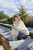 Beautiful woman with nice dog at railways royalty free stock images