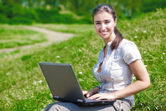 Beautiful woman with notebook on hill Stock Photos