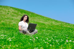 Beautiful  woman with notebook  on hill Stock Image