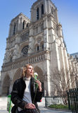 Beautiful woman  before Notre Dame de Paris Stock Images
