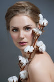 Beautiful woman with nude make-up and cotton. Fashion photo Royalty Free Stock Image