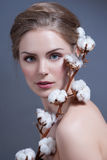 Beautiful woman with nude make-up and cotton. Fashion photo Royalty Free Stock Photography