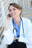 Beautiful Woman Nurse on phone Royalty Free Stock Image