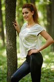 Beautiful woman in the oak forest Stock Image