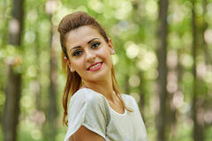 Beautiful woman in the oak forest Royalty Free Stock Photo