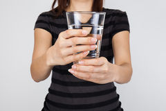 Beautiful woman offer a drinking water Royalty Free Stock Photography