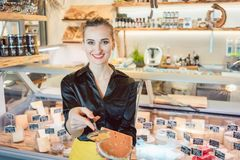 Free Beautiful Woman Offering Cheese On Delicatessen Counter Royalty Free Stock Photos - 126928758