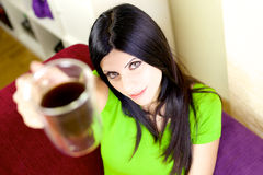 Beautiful woman offering coffee Stock Images