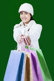Beautiful woman offering shopping bags Royalty Free Stock Image
