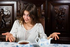 Beautiful woman offering you a cup of hot tea Royalty Free Stock Photos