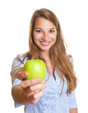 Beautiful woman offers an apple Stock Image