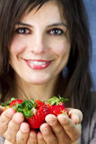 Beautiful woman offers  strawberry fruits Stock Photography