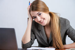 Beautiful woman at the office Stock Photos