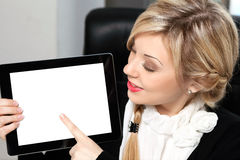 Beautiful woman in the office holding a tablet with isolated scr Stock Photos