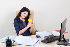 Beautiful woman at office inviting to coffee Stock Photo