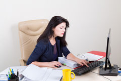 Beautiful woman at office working on computer Royalty Free Stock Images