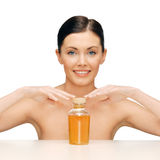 Beautiful woman with oil bottle Stock Image