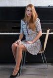 Beautiful woman and old black piano Stock Photo