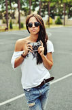 Beautiful woman with old camera Royalty Free Stock Photos