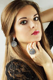 Ethnic jewelry. Beautiful woman in an old ethnic silver jewelry Royalty Free Stock Image