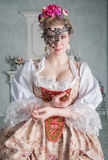 Beautiful woman in old-fashioned medieval dress with mask Stock Photography