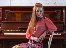 Beautiful woman and old piano Royalty Free Stock Image