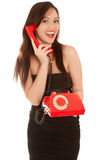 Beautiful woman with old red telephone talking Royalty Free Stock Photography
