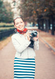Beautiful woman with old retro camera Stock Images