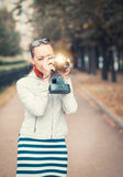Beautiful woman with old retro camera Royalty Free Stock Photo