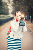 Beautiful woman with old retro camera Stock Photography