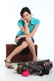 Beautiful woman with an old suitcase Royalty Free Stock Photography