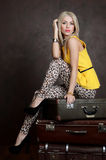 The beautiful woman with old suitcases Royalty Free Stock Photo