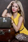 The beautiful woman with old suitcases Stock Photography