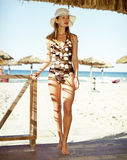 Beautiful woman in a one-piece bathing suit. Beautiful and elegance young woman in a one-piece bathing suit and hat Royalty Free Stock Image