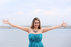 Beautiful woman with open arms looking at the camera Stock Photography