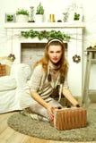 Beautiful woman open Christmas gift Stock Photo