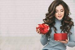 Beautiful woman open red gift box heart. stock photography