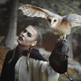 Beautiful woman and open winged owl. Fantasy and myth stock photography