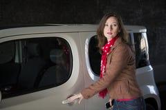 Beautiful woman opening car door Royalty Free Stock Images