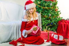 Beautiful woman opening a Christmas gift Stock Photo