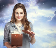 Beautiful Woman Opening a Gift Box. Beautiful Young Woman Opening a Gift Box Royalty Free Stock Photography