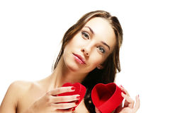 Beautiful woman opening heart shaped present box Stock Photos