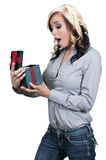 Beautiful woman opening a present Stock Photography