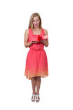 Beautiful woman opening a present. Beautiful young woman opening a gift or present Stock Photography
