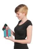 Beautiful woman opening a present Stock Image