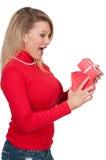 Beautiful woman opening a present Stock Photo