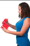 Beautiful woman opening a present Stock Images