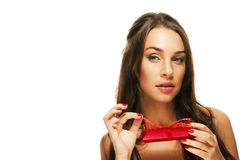 Beautiful woman opening red present Royalty Free Stock Images